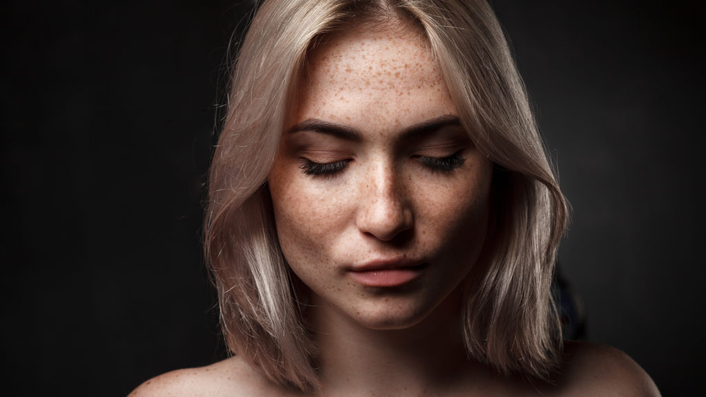 pretty freckled blond with eyes closed