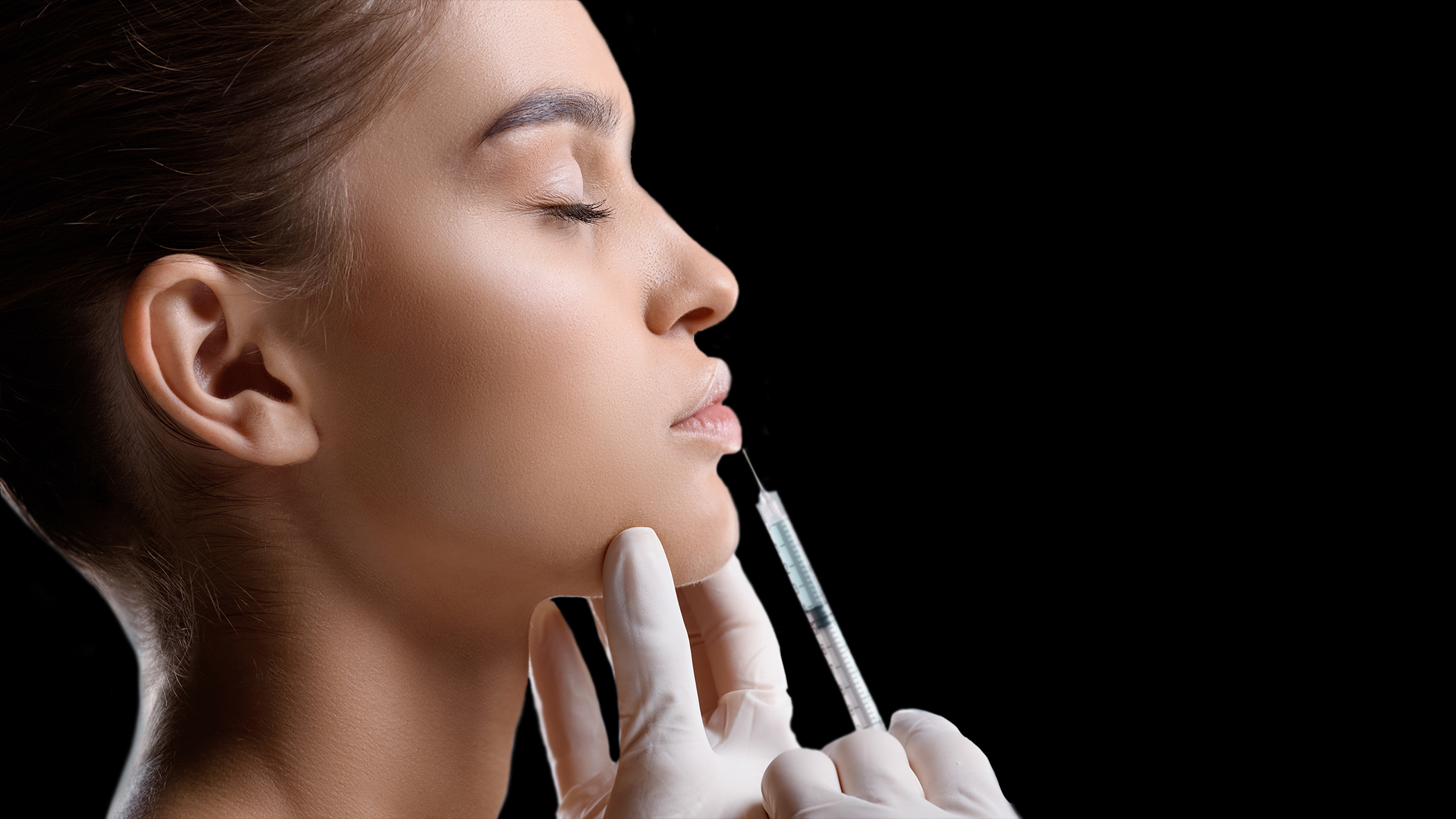 Portrait of attractive woman getting botox injection