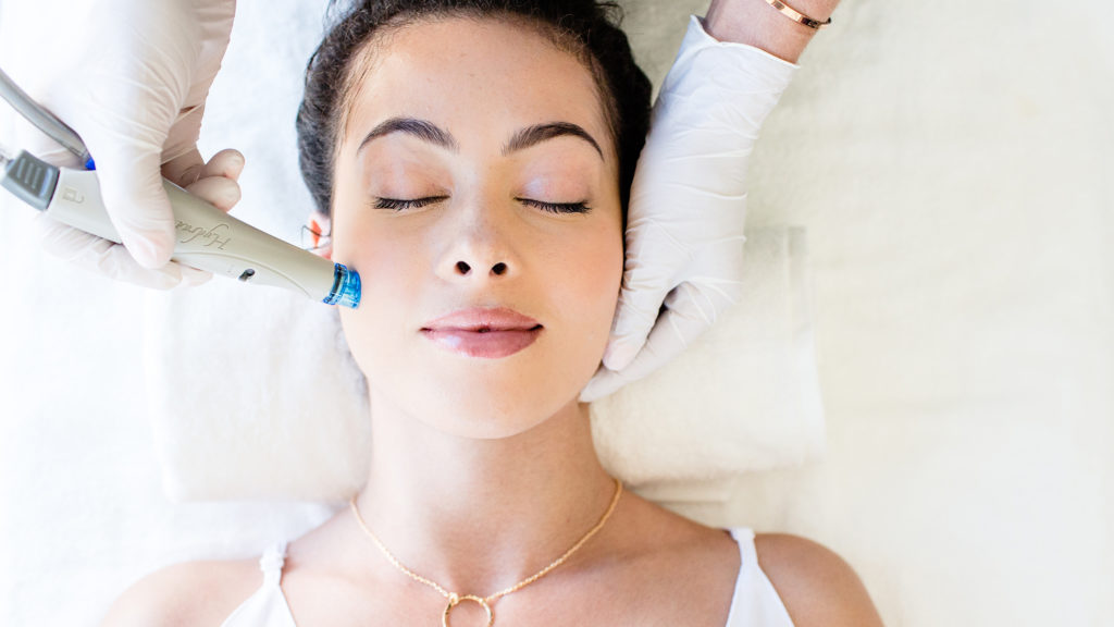 Woman resting while getting Hydrafacial treatment