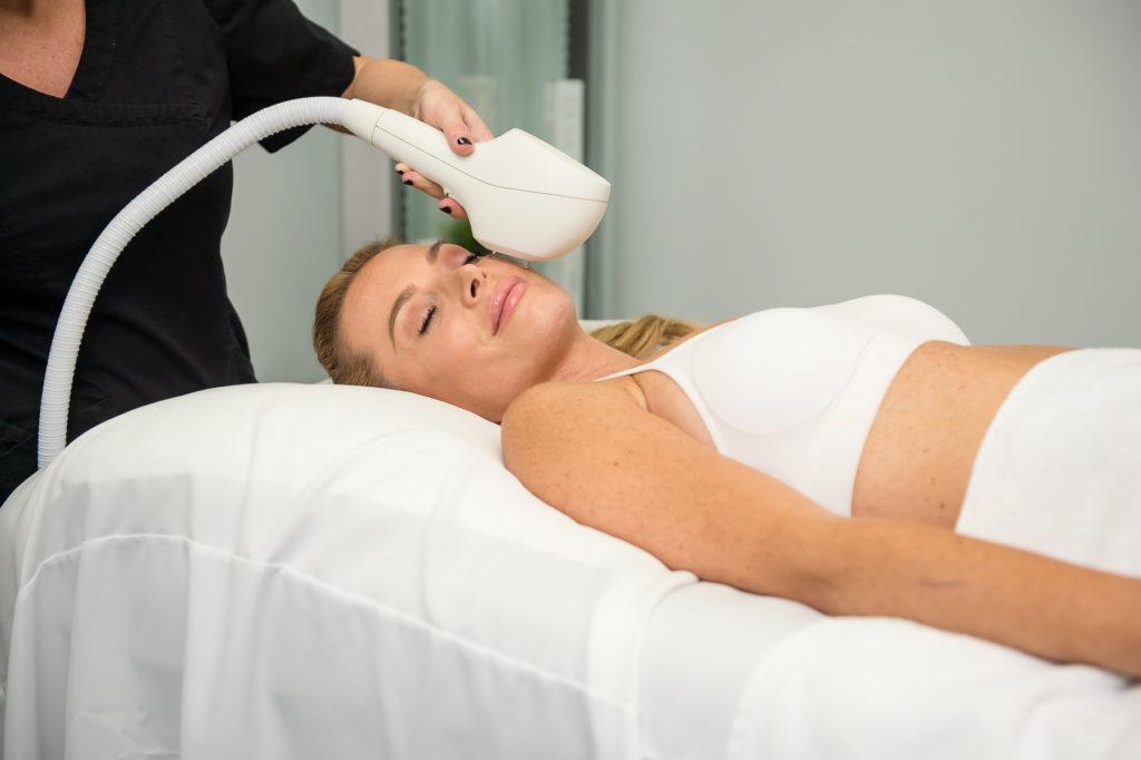 woman undergoes a facial treatment