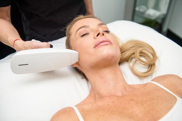 applying treatment to facial skin